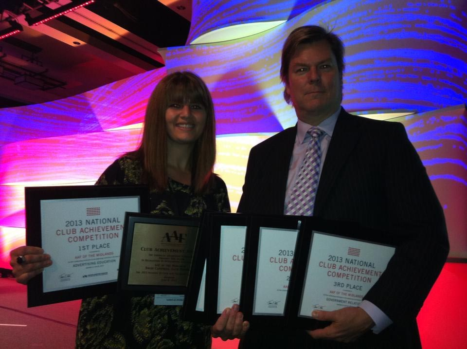 danielle and david pose with their awards at national convention