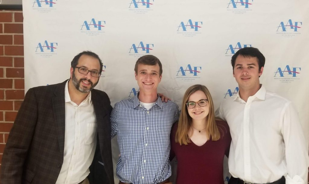 students pose in front of aaf step and repeat