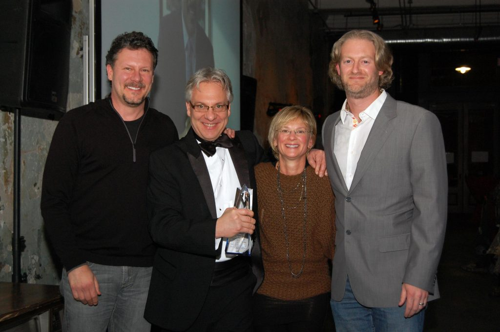 Mad Monkey group with award from American Advertising Awards gala