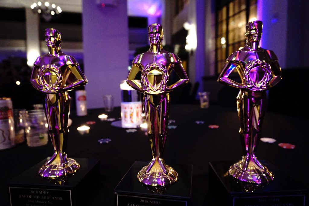 image of addy awards with purple lights reflecting