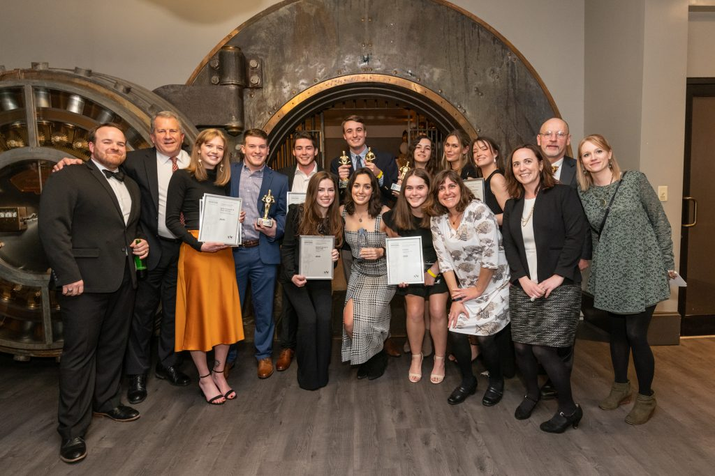 large group shows off their awards from the gala