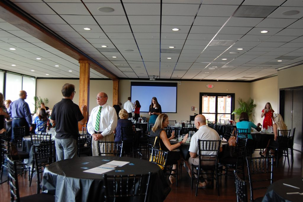 Members networking during a luncheon