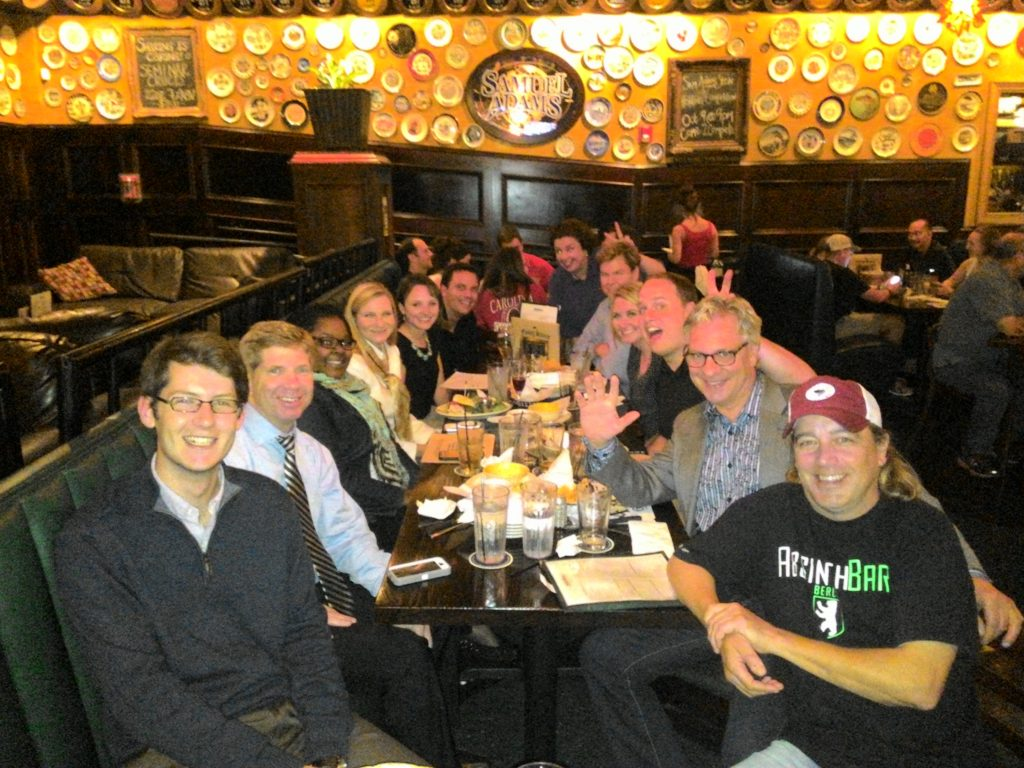 Group shot of people at table at flying saucer